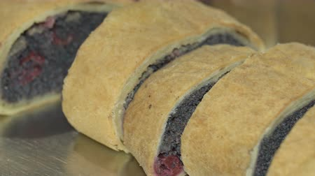 makowiec : Poppy and cherry seed strudel on a plate.