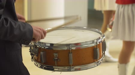 roll up : Drummer man playing on the snare drum in a concert. Stock Footage