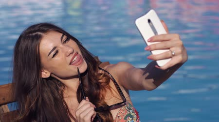 self portrait photography : Close up Young sexy woman make selfie near swimming pool