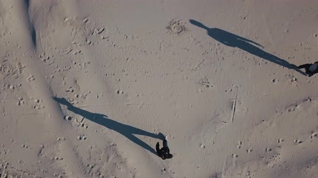 neutro : Aerial shooting. The top view of the three men goes to each other in the sand. The shadow of people. Drug trafficking, illegal business, meeting in a neutral territory concept