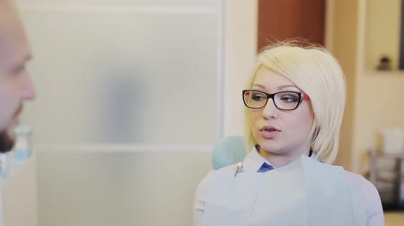 blonde with glasses talking with your dentist