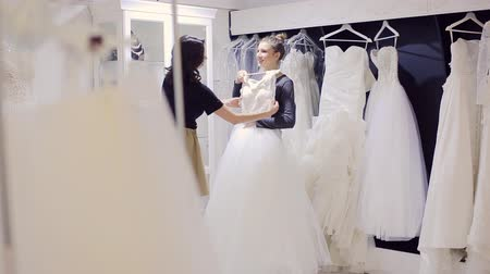 подвенечное платье : Wedding Dress Fitting in Bridal store