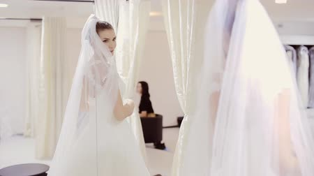 weddings : bride in wedding dress before the mirror Stock Footage