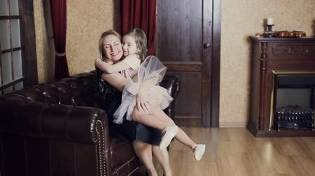 sarılmak : Daughter rushes into mothers arms at home and gives her a big hug