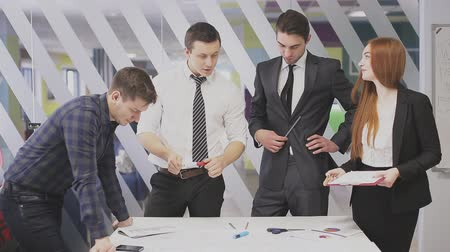 team of professionals discusses the project, brainstorming in a business meeting Stok Video