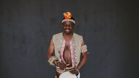 aborigine : African Man Playing Drum and smile