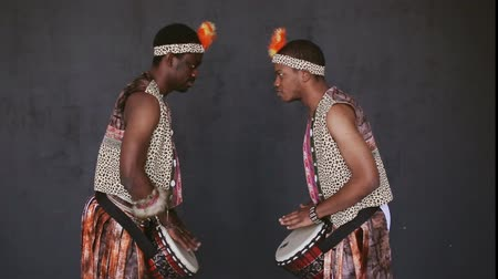 aborigine : Two African mans dancing and drumming Stock Footage