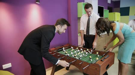 Office workers playing table football Stok Video