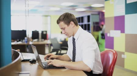 man hand typing on keypad of his laptop. Man is working in office at computer.