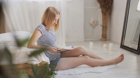pretty teen girl read book at home