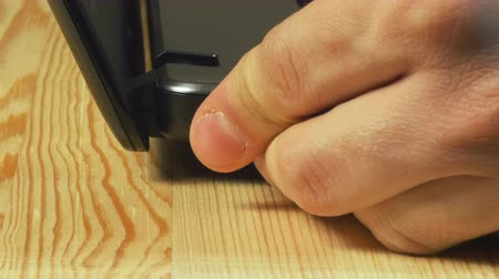 unplug : Close-up view of man insert laptop battery charge