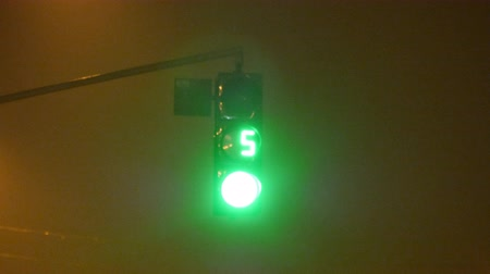 proceed : Close-up of traffic lights with timer from green to red at night Stock Footage