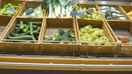 aisles : Moving past fresh vegetables in a supermarket. Grocery aisles in the store. Close up Stock Footage