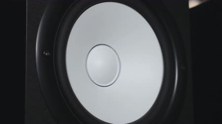 watt : Close up of moving sub-woofer on recording studio. White speaker pulsating and vibrating from listening of loud music on low frequency. Work of modern high fidelity loudspeaker membrane. Slow motion