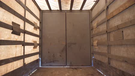 View from inside of an empty semi trailer. Truck before downloading the product. Close up Stock Footage