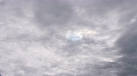 heavenly : Dark rainy clouds moving on darkening sky. Beautiful nature background. Weather concept. Timelapse Close up