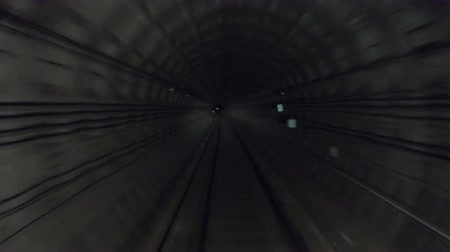 vanish : Time lapse of subway train moving at dark tunnel. Fast speed underground train riding in a tunnel of the modern city. Point of view from the railway cabin. Concept of morning commute. Timelapse POV Stock Footage