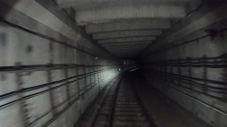 vanish : Fast speed underground train riding in a tunnel of the modern city. Time lapse of subway train moving at dark tunnel. Point of view from the railway cabin. Concept of morning commute. Timelapse POV Stock Footage