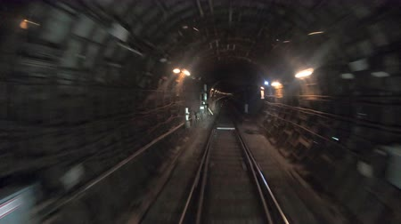 vanish : Point of view from the railway cabin. Fast speed underground train riding in a tunnel of the modern city. Time lapse of subway train moving at dark tunnel. Concept of morning commute. Timelapse POV Stock Footage