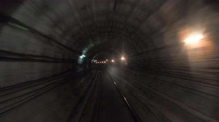 vanish : Time lapse of subway train moving at tunnel. Fast speed underground train riding in a tunnel of the modern city. Point of view from the railway cabin. Concept of morning commute. Timelapse POV