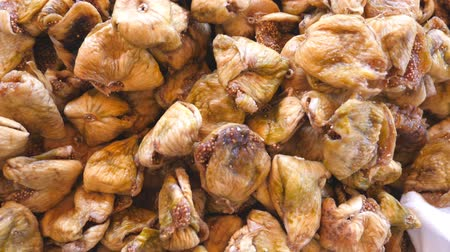 fichi : Detail view on pile of dried figs. Close up of falling sweet and tasty berries. Healthy food concept. Slow motion Top view