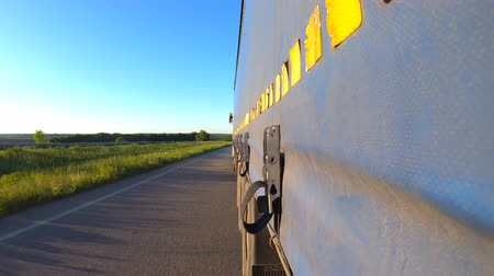 camionagem : Truck driving on highway. Lorry rides through countryside. Point of view at the car traffic from the trailer of tractor going at asphalt road. Concept of trucking and commercial vehicle. Time Lapse