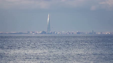 Lakhta Center through the Gulf of Finland in summer sunny day Stock mozgókép
