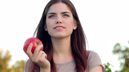 фрукты : Portrait of smiling beautiful girl close up with apple in park