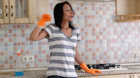 houseclean : Tired housewife after cleanup Stock Footage