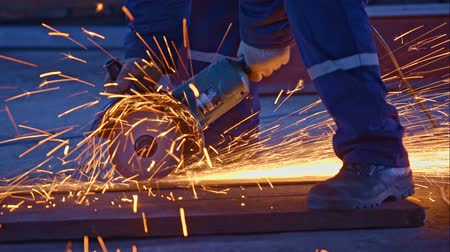 metal worker : Worker cutting metal with grinder Stock Footage
