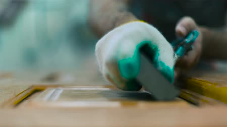 recondition : Worker carefully restores furniture in workshop Stock Footage
