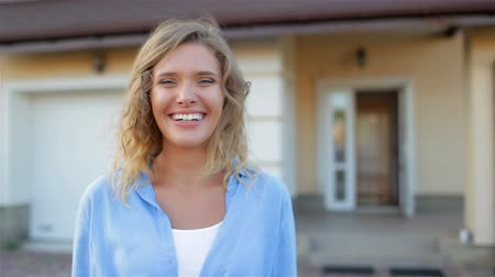 outside view : Beautiful girl next to her house Stock Footage