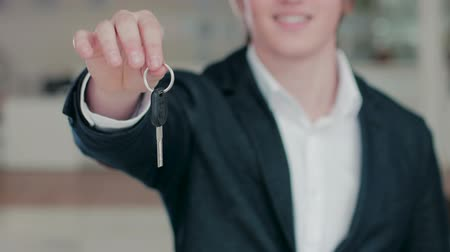 new car : Close up of mans hand handing a car key Stock Footage