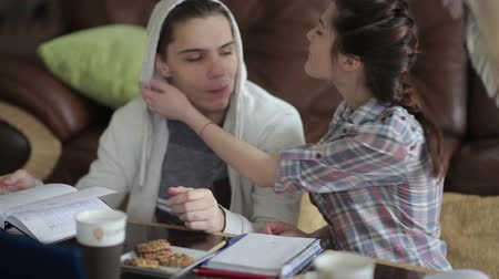 yanak : Girl is feeding cookies her boyfriend.