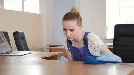 dirty : A cleaning lady cleans office desk. Stock Footage