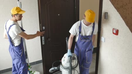cleaning equipment : Cleaners come out of the office.