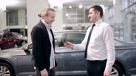 new car : Successful deal in the car dealership Stock Footage