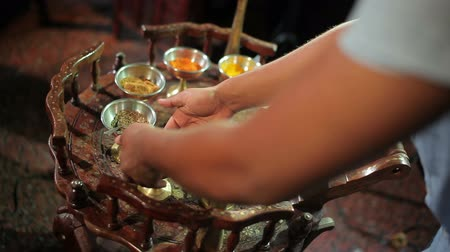 aphrodisiac : The cook mixing the spices in a bowl