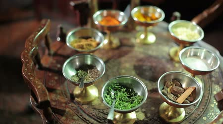 exotic dishes : Indian spices at the wooden table Stock Footage