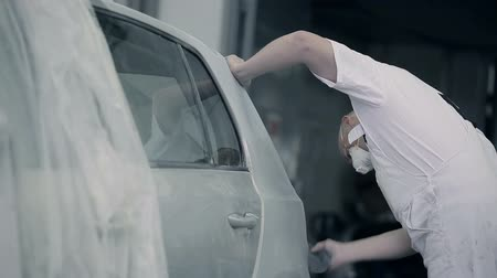 repaint : An employee cleans a car bumper. Stock Footage