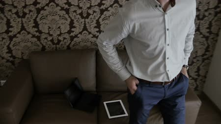 garça real : Man puts the tablet and gets up from the sofa. Stock Footage