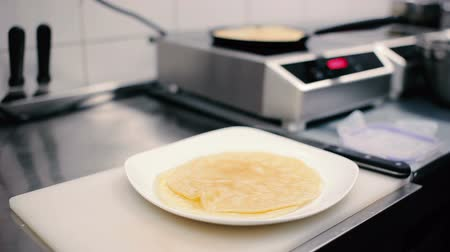 healthyfood : Close-up - the chef cooking the pancakes on a pan Stock Footage