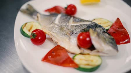 healthyfood : Fish decorated with cherry tomatoes. Stock Footage