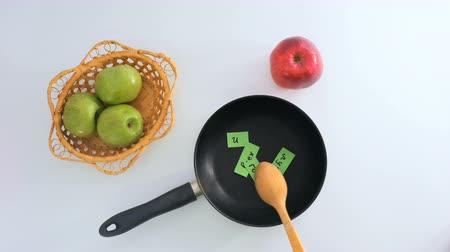 szavak : Ð¡omposition with pan, pieces with words, decorative apples on white background Stock mozgókép