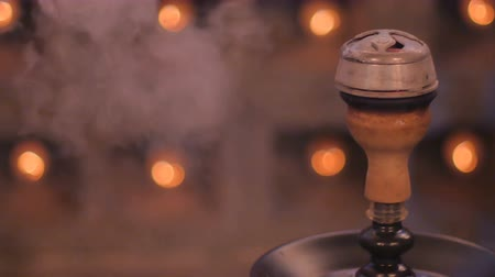 lower part : Close-up - the hot kaloud with coals from hookah Stock Footage