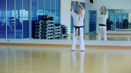 tanítvány : Beautiful blonde show a karate trick in the gym