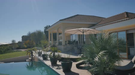 holiday villa : Beautiful view with swimming pool and villa Stock Footage