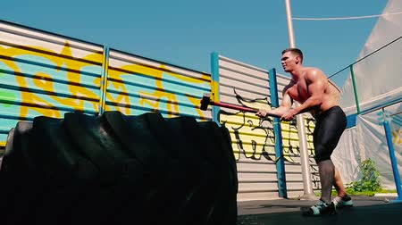 grapple : Strong sportsman training with hammer on the sports ground Stock Footage