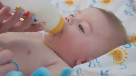 nipple : Portrait of adorable baby eat the mixture from bottle