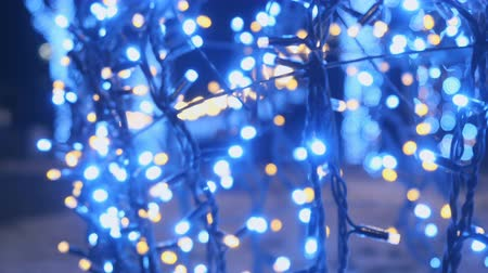 blinking light : The garland with colorful lamps at night